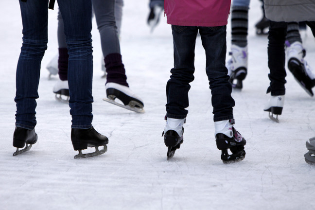 Feet with skates on an ice rink